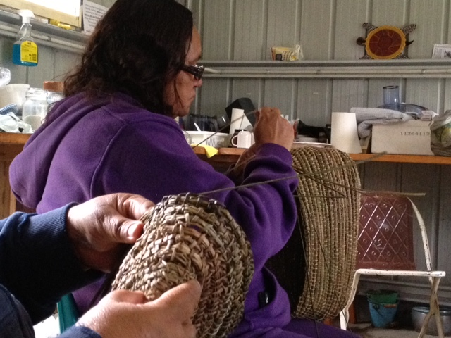Aboriginal women artists from the Wake Up Time Group in Casino NSW weaving baskets
