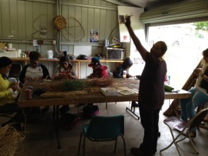 Aboriginal women artists from the Wake Up Time Group in Casino NSW run a basket-weaving workshop with students from Casino High School