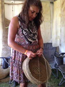 Kylie Caldwell doing traditional Aboriginal basket-weaving at the Wake Up Time Group stand at The Boomerang Festival in 2013.